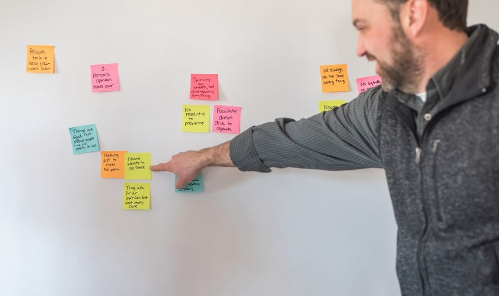 participant in a sticky note exercise on meeting planning