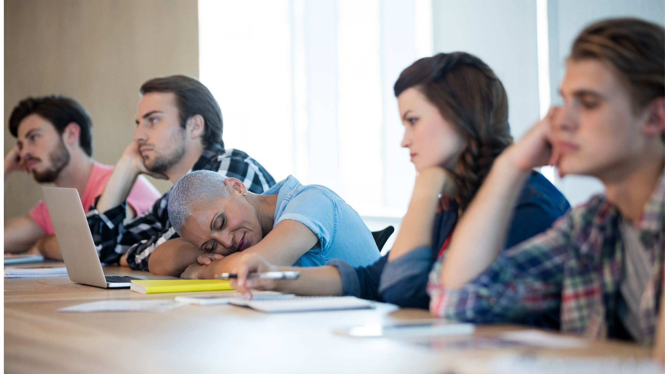 bored attendees at a meeting falling asleep
