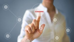pointing to the word coaching among a web of dots