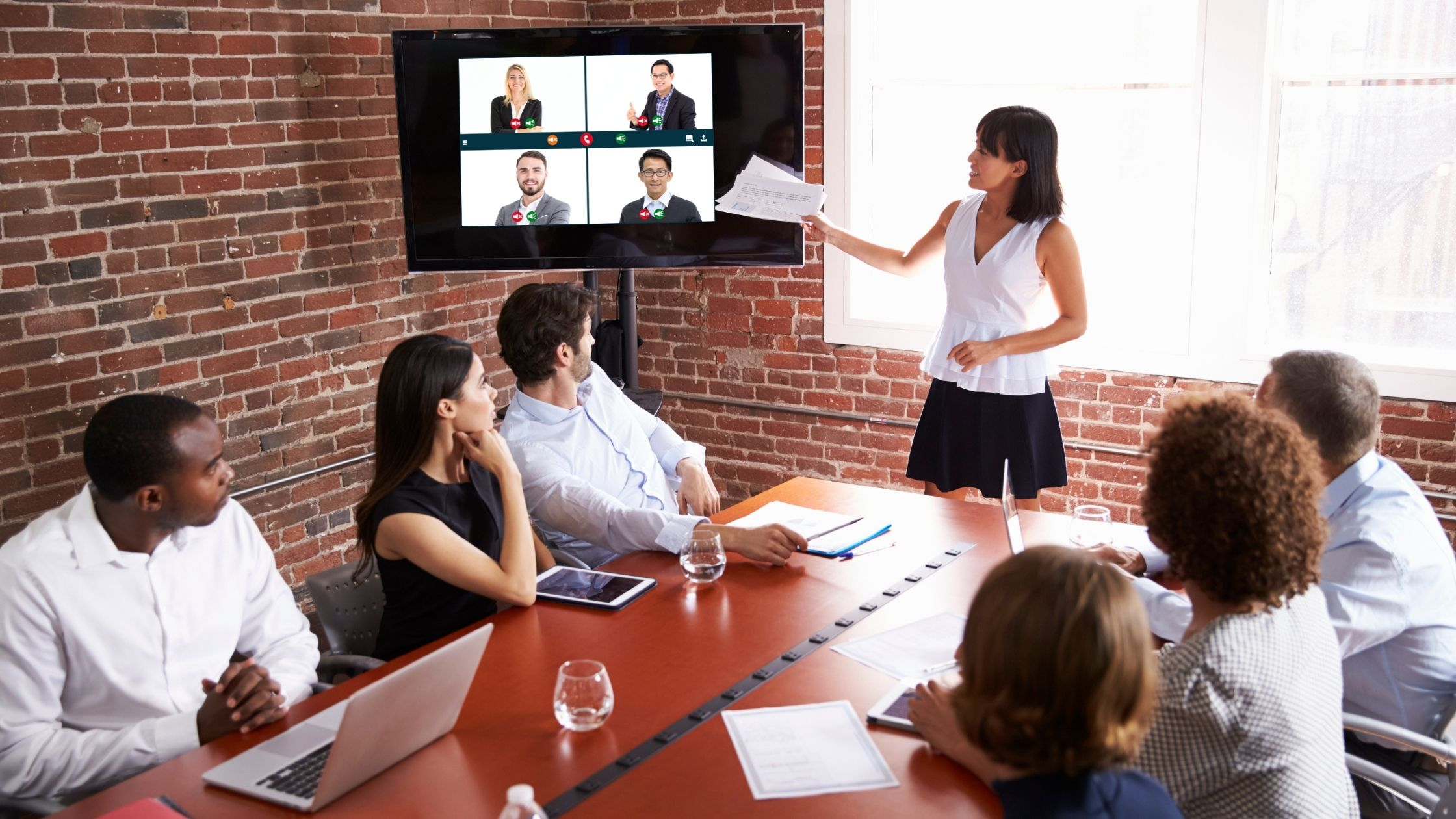 Meeting room with some folks on a screen