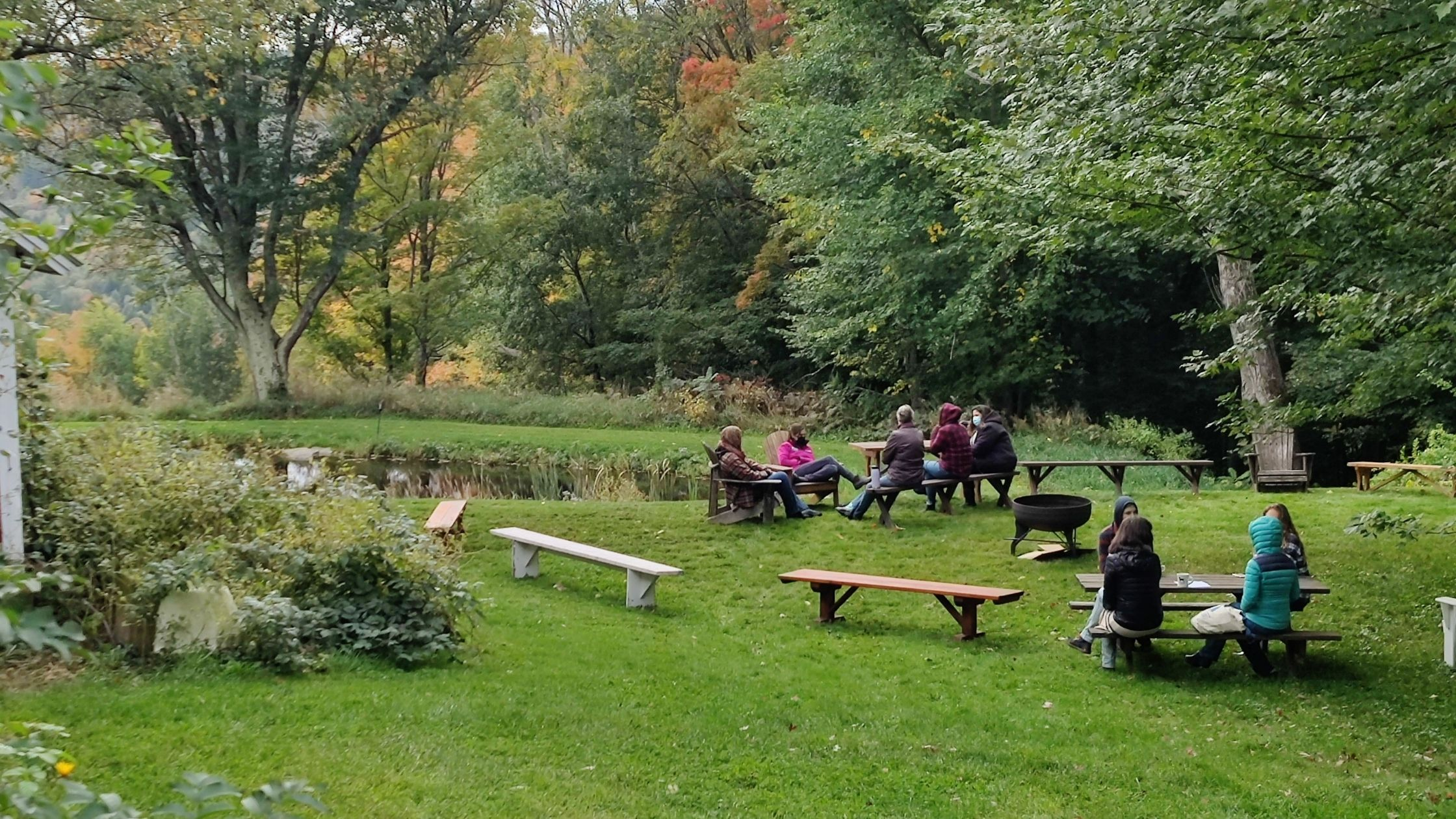 retreat attendees gathering on the lawn